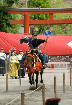Maintaining ties to its feudal past, a yabusame (mounted samurai archer) fires an arrow at a target from his galloping horse...