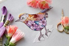 Stunning colours and detailed stitchery.