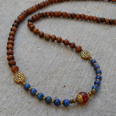 108 bead mala hand made with genuine lapis lazuli gemstones, and a Tibetan capped carnelian guru bead by Lovepray Jewelry