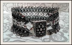 BEADS and GEMS by LPL :Bracelet - St. Petersburg stitch - 11/o seed beads , 4mm fire pilished beads , 3mm rondelles - in black and silver colours. Design  :   A road less travelled  by Jill Wiseman.