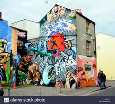 Download this stock image: Buildings covered in approved graffiti art in the North Laine area of Brighton city centre UK - bjn101 from Alamy's library of millions of high resolution stock photos, illustrations and vectors.