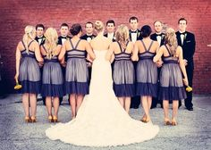 Cute way to show off the back of the dresses.... Don't know why it annoys me so much that one has her legs crossed. All or none girls, LOL.