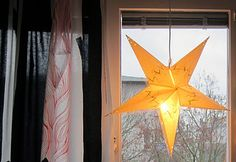 At home: paper christmas star.