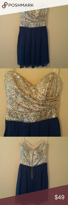 """Strapless Sequin Cocktail Holiday Party Dress B Darlin Gorgeous silver sequins cover the draped strapless bust area. Chest top is rimmed with silicone to keep top in place. Back is slightly elasticized. Sheer, but fully lined blue pleated bottom is flowy. Size 3/4. Measures 14""""across at chest lying flat. Measures 26""""from bust to hem. B Darlin  Dresses Strapless"""