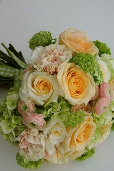 Peaches cream wedding bouquet - peach avalanche, crème de la crème and vendela roses, with touches of ranunclus, green hydrangea, viburnum opulus and dianthus.  perfect flowers for a spring wedding