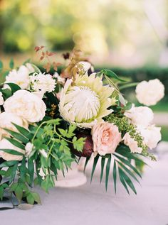 Protea + rose wildflower centerpiece: http://www.stylemepretty.com/2016/03/02/tropical-floral-inspired-spring-dallas-wedding/ | Photography: Sarah Kate Photo - http://sarahkatephoto.com/
