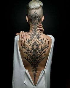 Enjoy body art brilliance with awesome back tattoos for men and women that are masterpieces. The back is one of the most spacious areas for tattoos on the body. If you are looking for the best full-back tattoo idea then this collection is for you. Head Tattoos, Body Art Tattoos, Tatoos, Tattoo Neck, Henna Tattoo Back, Wing Tattoo Men, Nape Tattoo, Chicano Tattoos, Dot Work Tattoo