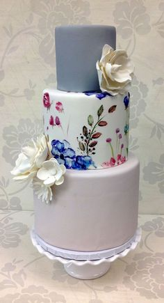 Hand-painted floral wedding cake from The Cupcake Shoppe in Raleigh.