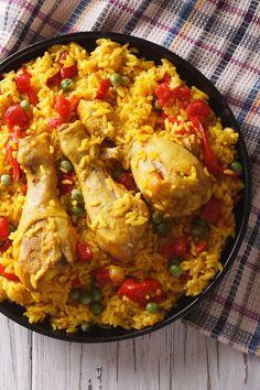 This arroz con pollo, or chicken with rice, is a typical Latin American dish. Puerto Rican Dishes, Puerto Rican Cuisine, Puerto Rican Recipes, Fried Red Snapper, Recetas Puertorriqueñas, Pollo Recipe, Boricua Recipes, Puerto Rico Food, American Dishes