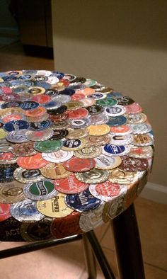 Bottlecap stool...here's so,ething we could do with our gazillion bottle caps!