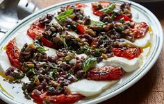 In this take on mozzarella caprese, grilling the tomatoes really brings out their flavor, while olives balance the sweetness.