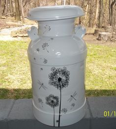 "refurbished ""milk"" can: primed and painted, adorned with dollar store wall decals."