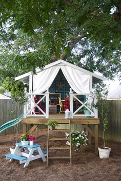 A Cozy Loft-ed Playhouse: This chic little space combines everything into one. With a slide, tent, and loft, this playhouse is quite the creative space. Source: Flickr user pannylife