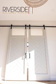 A large double barn door can add the perfect element of design into a room while still keeping the function of separating one room from another.