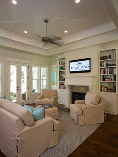 family room, built ins    Like the built-in fireplace and shelving. neutrals and bright pillows with open open windows for PLENTY of natural light :)