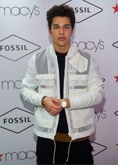 Taking to the step and repeat, Austin Mahone poses for pictures at Macy's Herald Square.