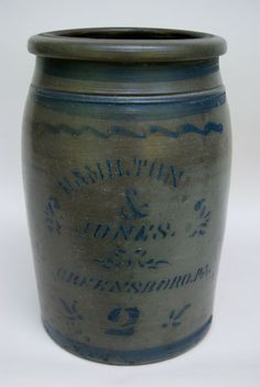 "Stenciled and Painted with Free Hand Stripes; Hamilton & Jones; Greensboro, PA -- This 12"" two gallon Hamilton and Jones storage jar is decorated with four freehand stripes and a good deal of stenciled cobalt decoration. This a fine example of antique American nineteenth century utilitarian stoneware from one of southwestern Pennsylvania's most celebrated potters. Nice blue with good application and excellent condition, with freehand stripes and wonderful color... (zandkantiques.com)"