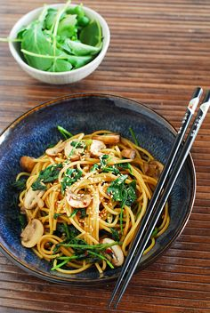 Spicy Asian Pasta with kale and mushrooms! This easy to prepare vegetarian dish is full of Asian flavors! Make this dish with any vegetables in your fridge!