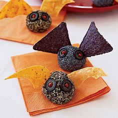 Bat shaped cheese log appetizers for Halloween