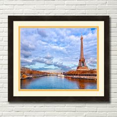 Framed Art print of the majestic Eiffel Tower rising above the beautiful skyline of Paris on the banks of the seine on a golden winter day