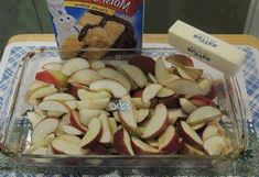 INGREDIENTS: 5-7 apples 1 (9 ounce) package yellow cake mix 2 tablespoons sugar 1 tablespoon ground cinnamon 1 stick real butter INSTRUCTIONS: Preheat oven to 350°F Fill your 9×12 pan 1/2 full with apples which you've peeled, cored and sliced thin Sprinkle the apples