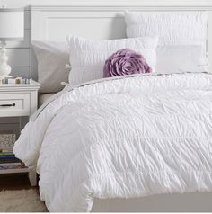 Pottery Barn Teen Queen White Ruched Duvet + standard Sham This cozy duvet cover is made of airy cotton percale that's been lightly gathered for a textured, pillowy effect. 100% cotton percale. Duvet cover and sham reverse to self. Duvet cover has interior ties and a hidden button closure; sham has tie closure at the side. Twin-sized duvet cover fits both standard twin and twin XL dorm mattresses. Duvet cover, sham and insert sold separately. Machine wash