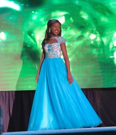 The year 2016 was a year of ball gowns when it came to the Preteen contestants. Many queens wore similar styles, which shows a trend in these gowns. Gone are the days when just the color pink dominated for younger contestants. As you will see, almost every color wowed a set of judges. Each of these girls shined on stage and picked a color perfect for her.  Without further ado, here are this year's best of the best preteen evening gowns of 2016. Here: Miss Preteen Louisiana Regan Davis