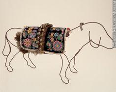 Saskatchewan: Metis and Dene dog blankets and bells. Dates unknown.
