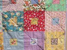 I want to do a 1930's quilt, but what I really love is the very simple quilting!