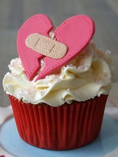 """Who in the world would ever give anyone this cupcake???? """"Sorry your life sucks, here's a band-aid heart on a cupcake to make you feel better."""""""