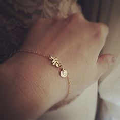 Dainty Leaf and Initial Bracelet   Everyday Jewelry  by cocowagner, $23.90   Would be perfect with a C and a K :)