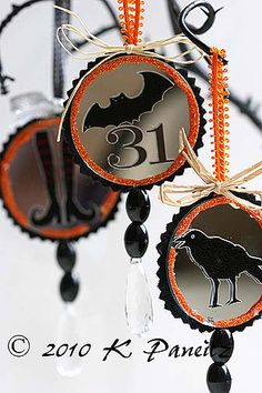 Halloween ornaments made using small mirrors.  These were published in the Oct 2010 issue of Crafts 'N Things magazine.