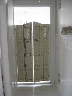 Repurposed shutters into swinging doors ~ absolutely love this!