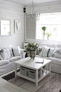 I am becoming obsessed with shabby chic and vintage looking homes. I adore all this white, but with dogs I don't think I could ever pull this off! :(