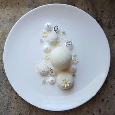 """Snow White"" - White chocolate mousse, coconut mousse, yuzu jelly, lychee jelly, coconut dacquoise…"