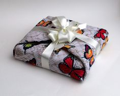 Luxury Gift Wrap, furoshiki cotton fabric reusable gift wrap with ribbon. £3.95, via Etsy.