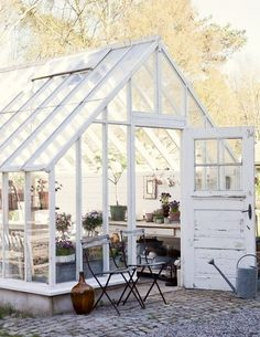 A guide to transforming your garden shed Rustic greenhouse and garden shed. Industrial style with outdoor seating and vases. More ways to revamp your garden shed at . Greenhouse Shed, Greenhouse Gardening, Simple Greenhouse, Indoor Greenhouse, Greenhouse Wedding, Homemade Greenhouse, Outdoor Rooms, Outdoor Gardens, Outdoor Living