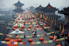 Lanterns and flags decorate the old city wall of Xi'an, Shaanxi Province, China. Photograph by Mike McQueen