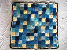 This is one of mom's granny square blankets,  I really like that there is a pattern hidden throughout if you can find it among the random color sequence.
