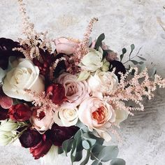 This bouquet makes such a dramatic yet delicate statement.