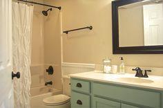 Small Basement Bathroom Design Ideas To Inspire You: Gorgeous Small Basement Bathroom with White Built-In Bathtub and Single Sink Bathroom Vanity also Black Towek Rail – Ewehome Interior Design Ideas and Furniture