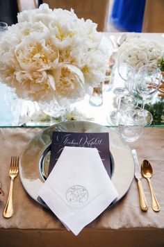 Placing a bouquet of peonies on a mirrored table runner gives the illusion of endless blooms.
