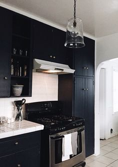 The darkest navy cabinetry