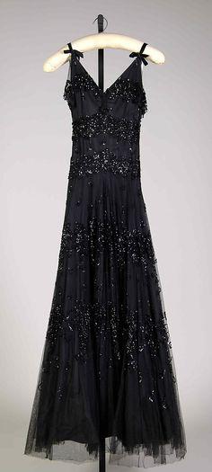 Evening dress Mme. Eta Hentz  Manufacturer: Ren-Eta Gowns, Inc. Date: fall/winter 1938–39 Culture: American Medium: Silk, sequins Accession Number: 2009.300.6524