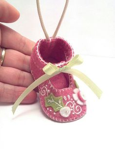 This little baby shoe ornament was all hand stitched, embroidered