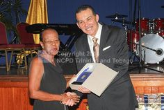 His Excellency Anthony Thomas Aquinas Carmona, O.R.T.T., S.C. presented an Award to Barbara Derry for Outstanding volunteerism.