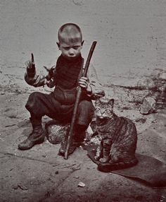 Ragged child and his cat. East End 1920s