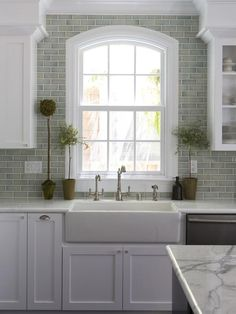 Modern Farmhouse Sink w/ Marble Backsplash  --> http://www.hgtv.com/designers-portfolio/room/traditional/kitchens/1950/index.html?soc=pinterest#/id-7093?soc=pinterest