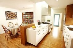 Separating dining and kitchen by using kitchen benches and cabinets