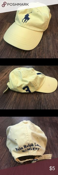 Polo Ralph Lauren yellow baseball hat Polo Ralph Lauren yellow baseball hat. with adjustable back. stains on bill of hat (pictured). navy blue embroidery. Polo by Ralph Lauren Accessories Hats